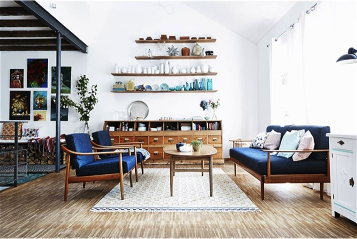 blue sofas and wood