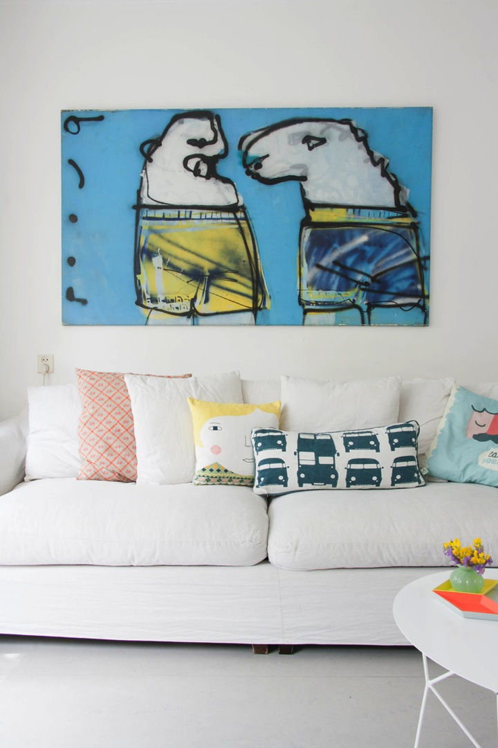 art above couch in colorful dutch row house