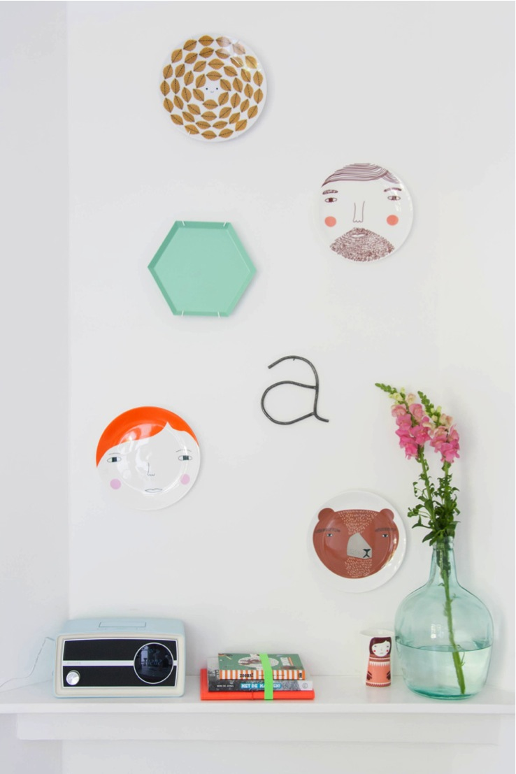 collection on the wall in colorful dutch row house