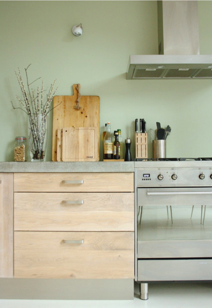 oak stainless steel and green wall in kitchen