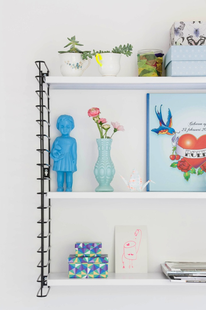 shelves in colorful dutch row house