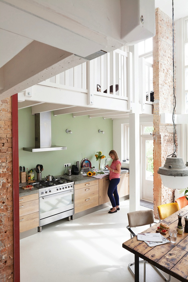 simple kitchen with green wall