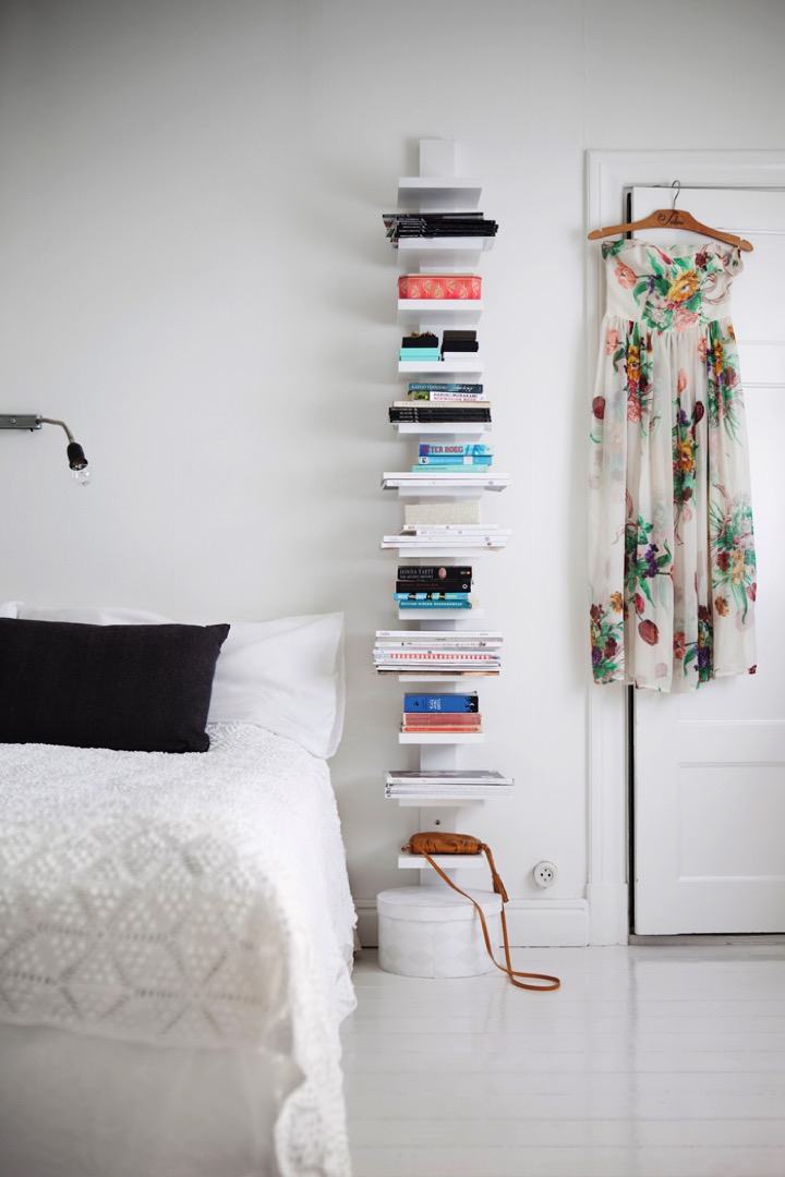 bookshelf by the bed
