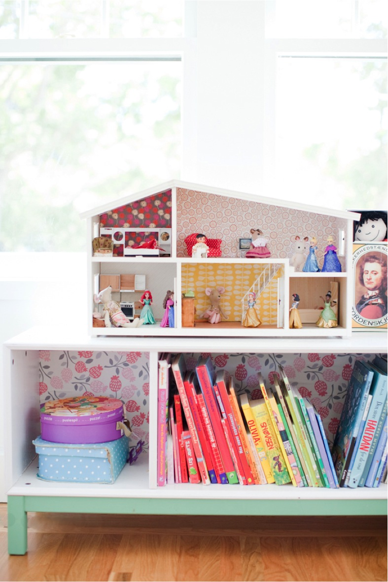 doll house and books organized by color