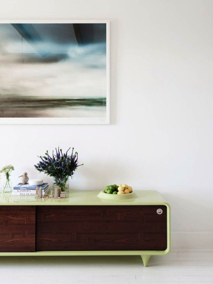 love the green on this wood media cabinet