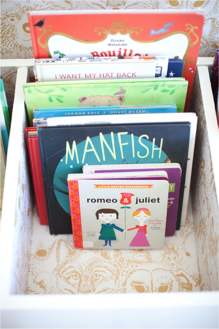 DIY kids book bin decorated with fun wallpaper