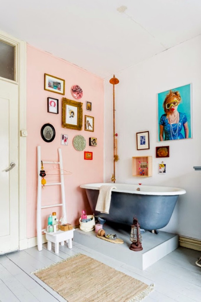 pink wall and clawfoot tub