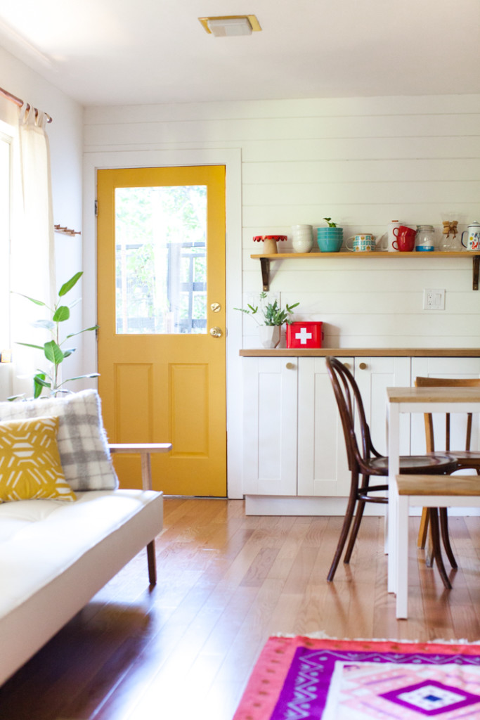 bright and cosy studio space with yellow door